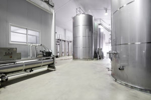 Empty modern wine cellar and stainless steel tanks